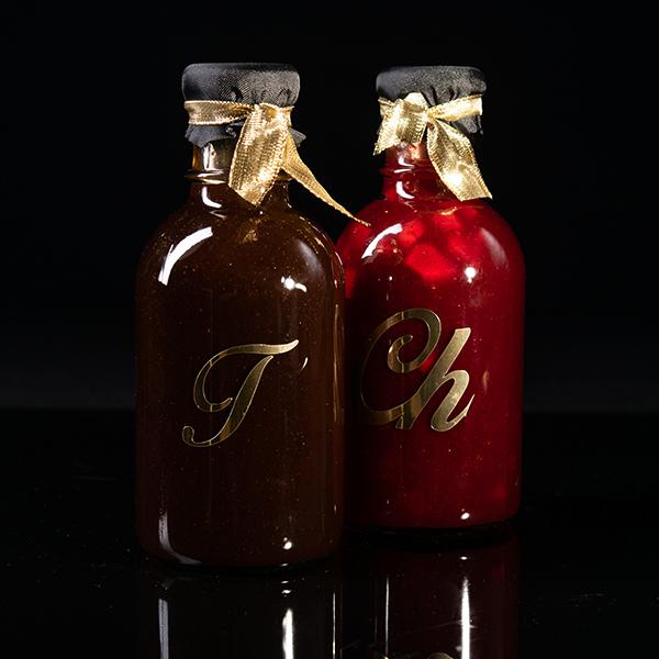 Caja con 2 Botellas de 500 ml (Salsa de Tamarindo y Salsa de Chamoy)